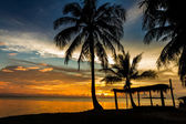 Tropical gazebo amazing beach with palm tree in silluate background — Stock Photo