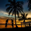 Tropical gazebo amazing beach with palm tree in silluate background  — Stock Photo