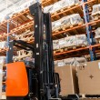 Foto Stock: Large modern warehouse with forklifts