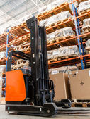 Large modern warehouse with forklifts — Stok fotoğraf