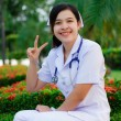 Asian female nurse with stethoscope  — Stock Photo
