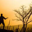 Praying man silhouette on sunset background — Stock Photo