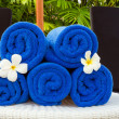 Towel and flower — Stock Photo