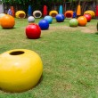 Colorful garden with ball chair — Stock Photo