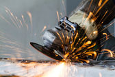 Metal grinding on steel pipe close up — Stock Photo