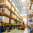 Foto Stock: Modern warehouse with forklifts