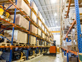 Modern warehouse with forklifts — Stock Photo