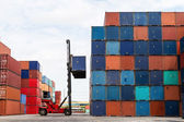 Crane lifting up container in yard — Stock Photo