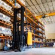 Стоковое фото: Modern warehouse with forklifts