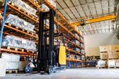 Modern warehouse with forklifts — Stok fotoğraf