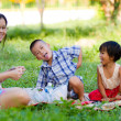 Happy mother with her daughter and son in the park — Stock Photo