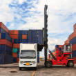 Stack of Freight Containers at Docks with Truck — Foto Stock #33349191