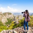 Nature Photographer taking pictures outdoors — Stock Photo