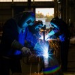 Stock Photo: Welders with protective mask in factory