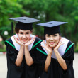 Happy young women graduate students with success gesture — Stock Photo #34940035