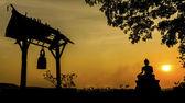 Buddha statue in sunset — Stock Photo