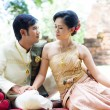 Thai man and woman in silk dress  — Stock Photo