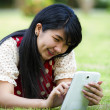 Asia woman using tablet outdoor  — Stock Photo