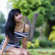 Beautiful Asian model outdoors smiling  — Stock Photo