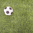 Stock Photo: Soccer ball on green field
