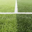 Green grass with white line of football field  — Стоковая фотография
