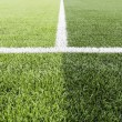 Green grass with white line of football field — Stock Photo