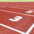 The beginning of the athletics track — Stockfoto