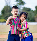 A smiling boy and a little girl in the park — Foto Stock
