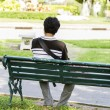 Stock Photo: Msitting alone on park