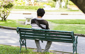 Man sitting alone on park — Stock Photo