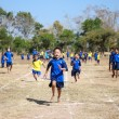 Unidentified Thai students 4 - 12 years old athletes in action during sport day — Stock Photo