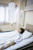 Woman patient in hospital bed — Stock Photo