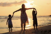 Mother with her daughter and son on the beach — Stock Photo