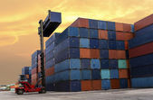 Forklift handling the container box at dockyard — ストック写真