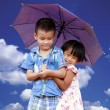Smiling boy and little girl with umbrella — Stock Photo #45142177