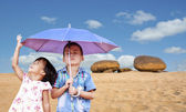 Boy and little girl in summer outdoor — Stock Photo