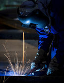 Worker with protective mask welding — Stock Photo