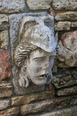 The human face of stone — Stock Photo