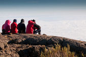 Team gazing over clouds — Stock Photo