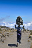 Porter above the clouds Kilimanjaro — Stock Photo