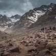 Stock Photo: Trekkers approaching refuge du Toubkal