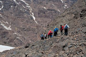 Group descending from summit of mountain — Stock Photo