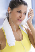 Sport woman with a towel — Stock Photo