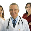 Senior male doctor with his administration — Stock Photo