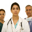 Female doctor with surgeon and nurse — Stock Photo