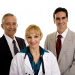 Female doctor with administrators — Stock Photo