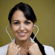 Doctor with stethoscope in ears — Stock Photo