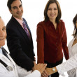 Doctor with his office support staff — Stockfoto
