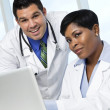 Male and female doctors with laptop — Stock Photo
