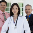 Doctor with businessmen — Stock Photo